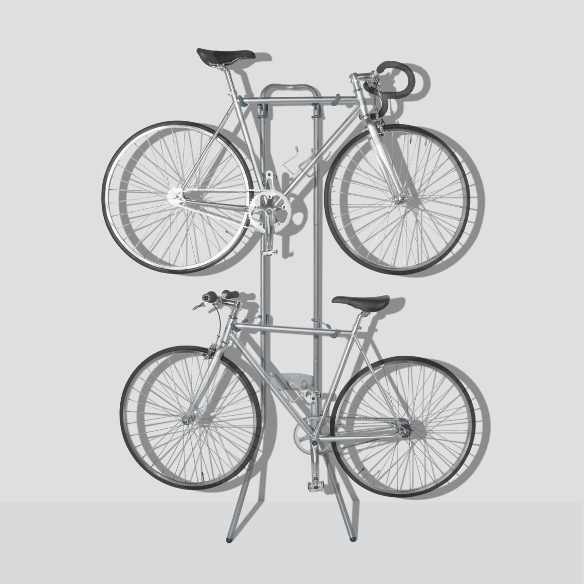 two bikes hang from the Angetenar Freestanding Bike Rack