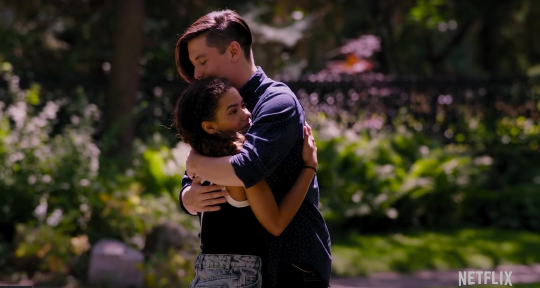 Ginny awkwardly hugging boy