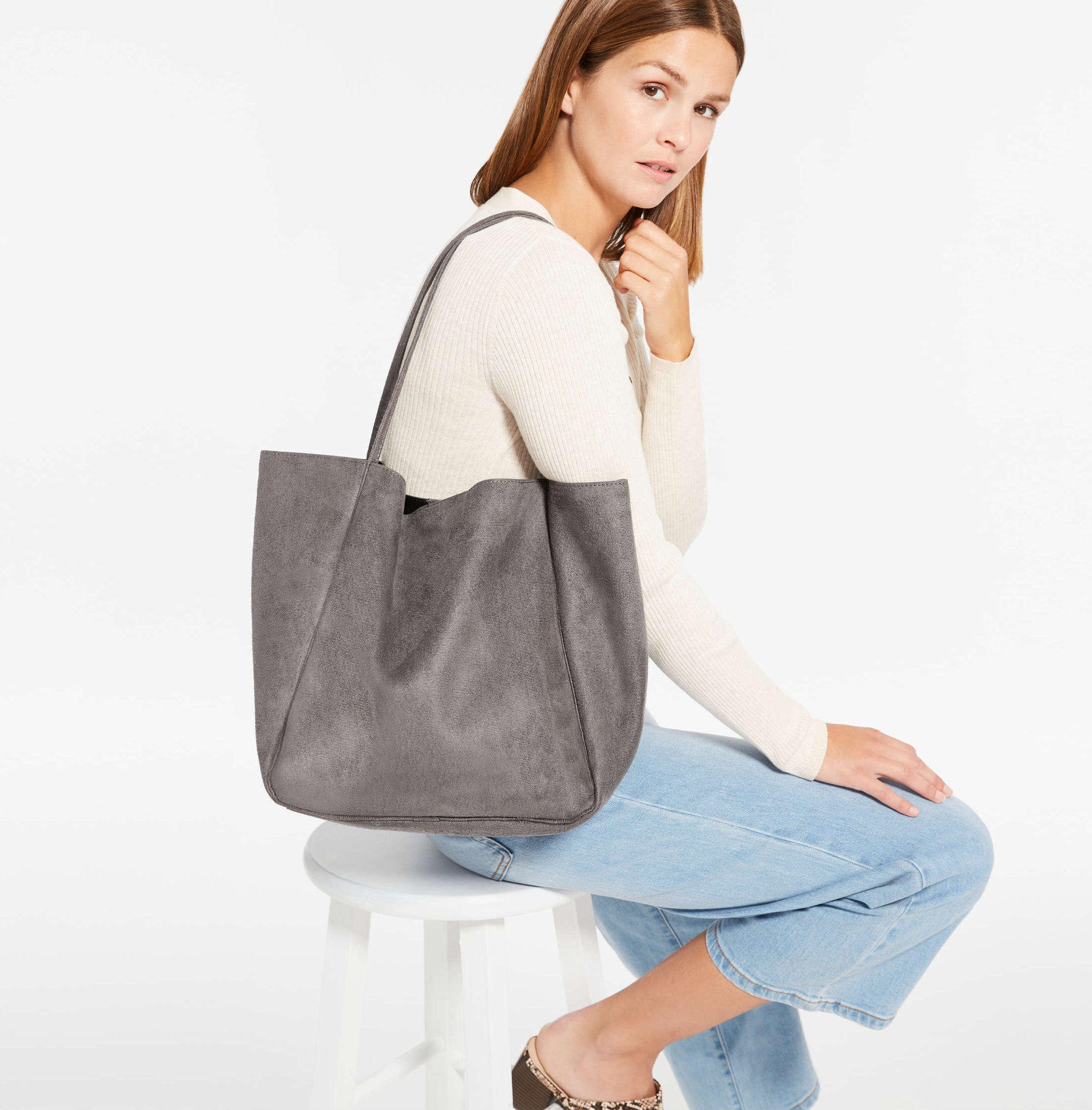 A person wearing a large tote bag over their shoulder