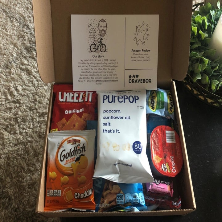 Reviewer photo of opened CraveBox with various snacks