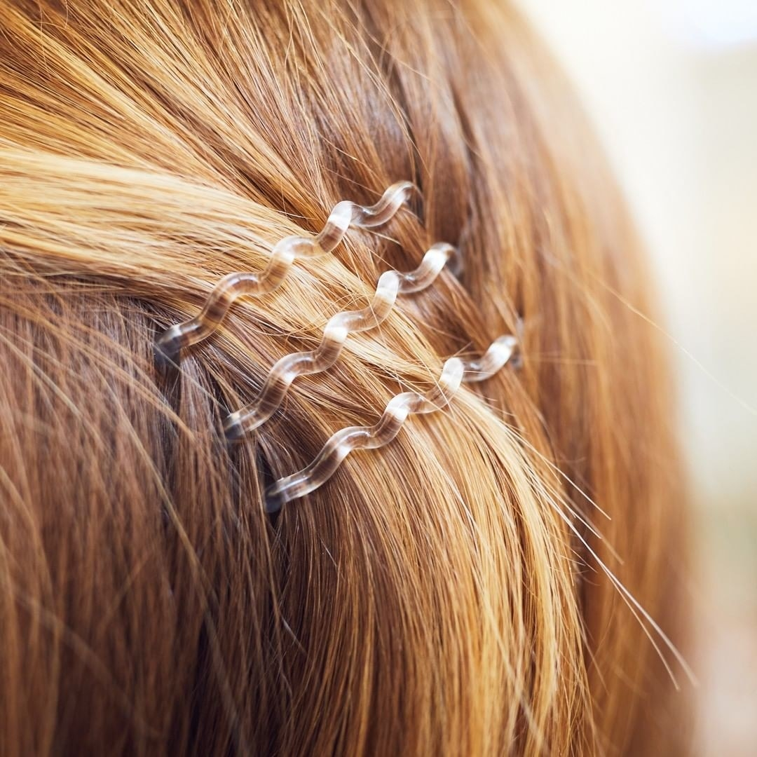 A close up of a trio of the hair clips on someone's hair