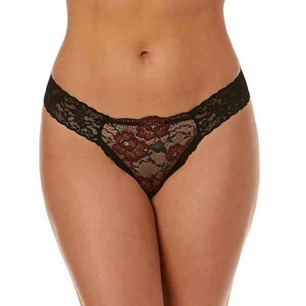 a model wearing a black lace thong with red flowers on it