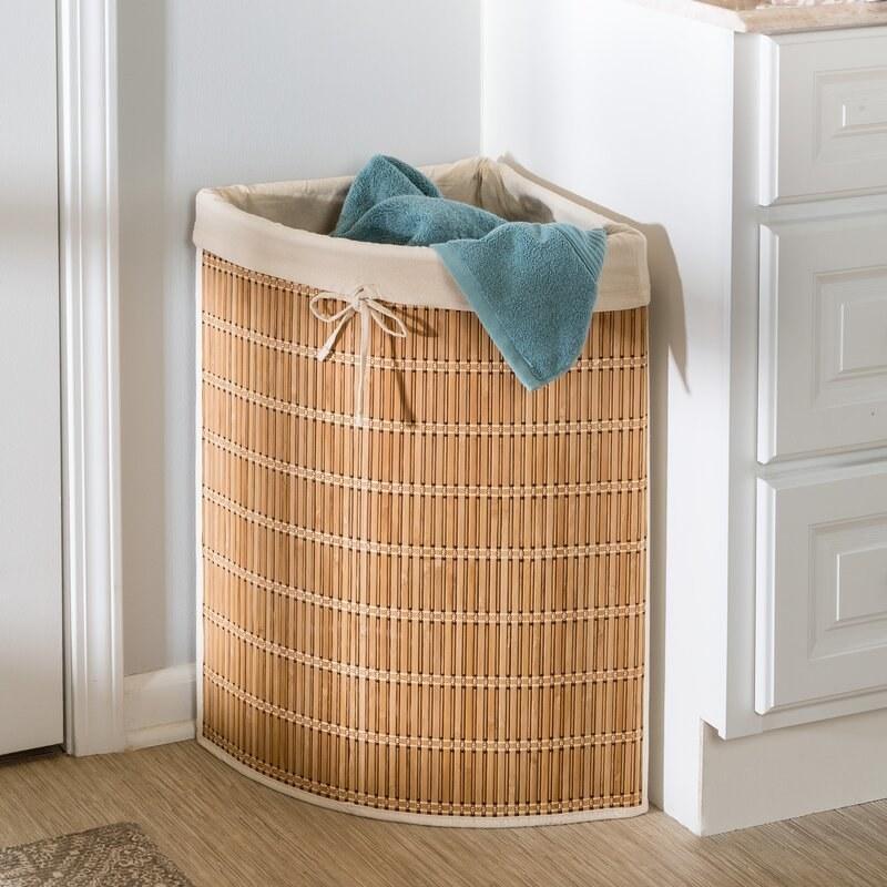 The rattan hamper tucked into a corner