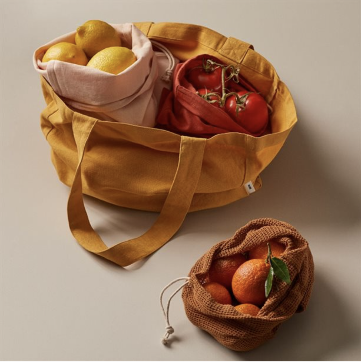 reusable bags filled with fruits and vegetables