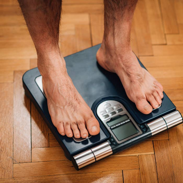 Man weighing himself on the scale