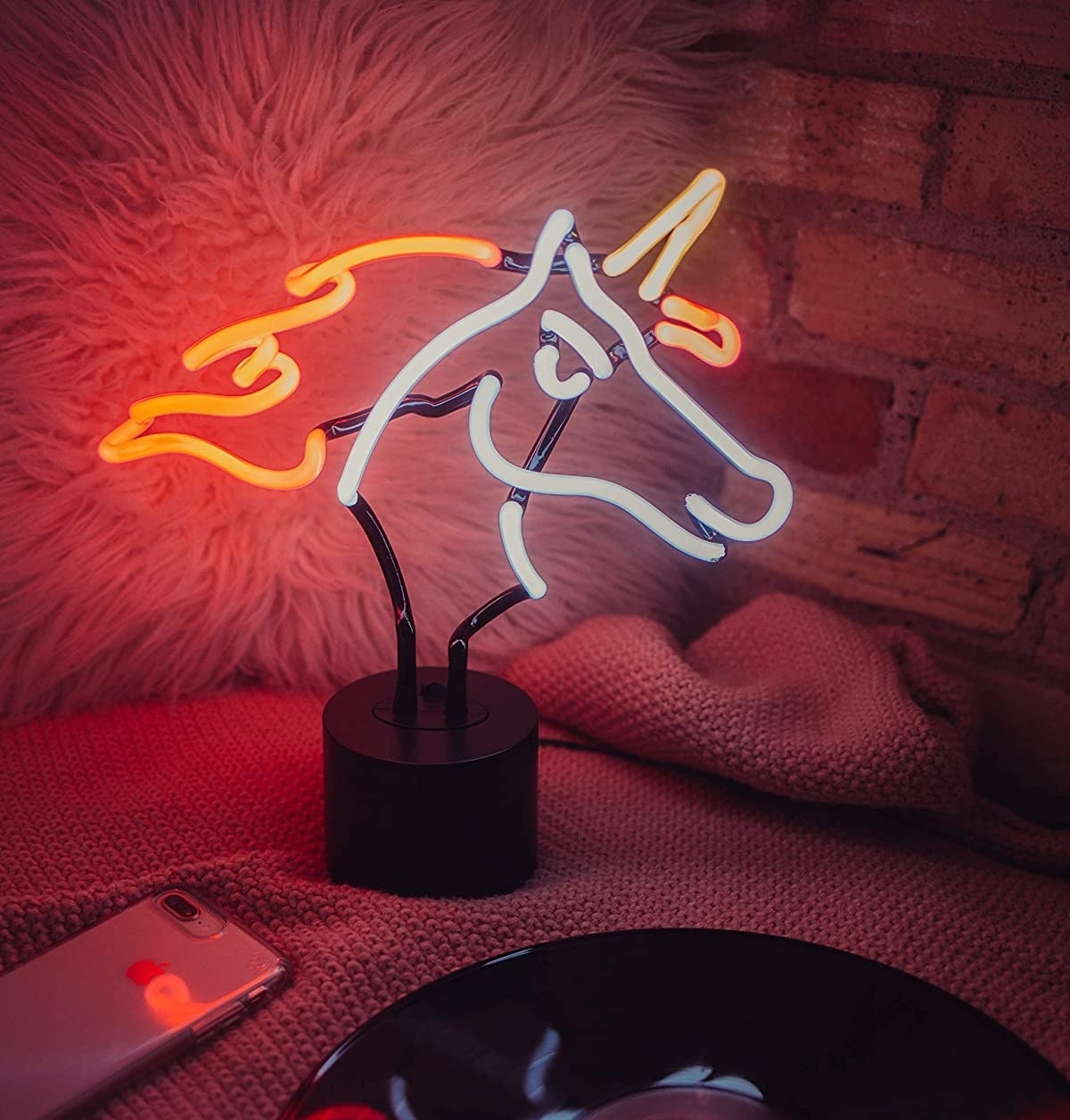 The unicorn light on a bed