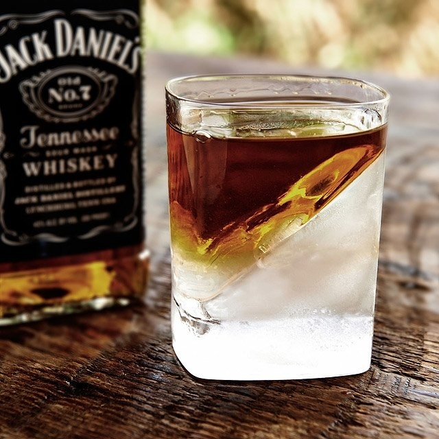 Clear glass with ice and whisky