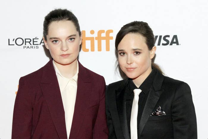 Emma Portner and Elliot Page posing for a photo at an event