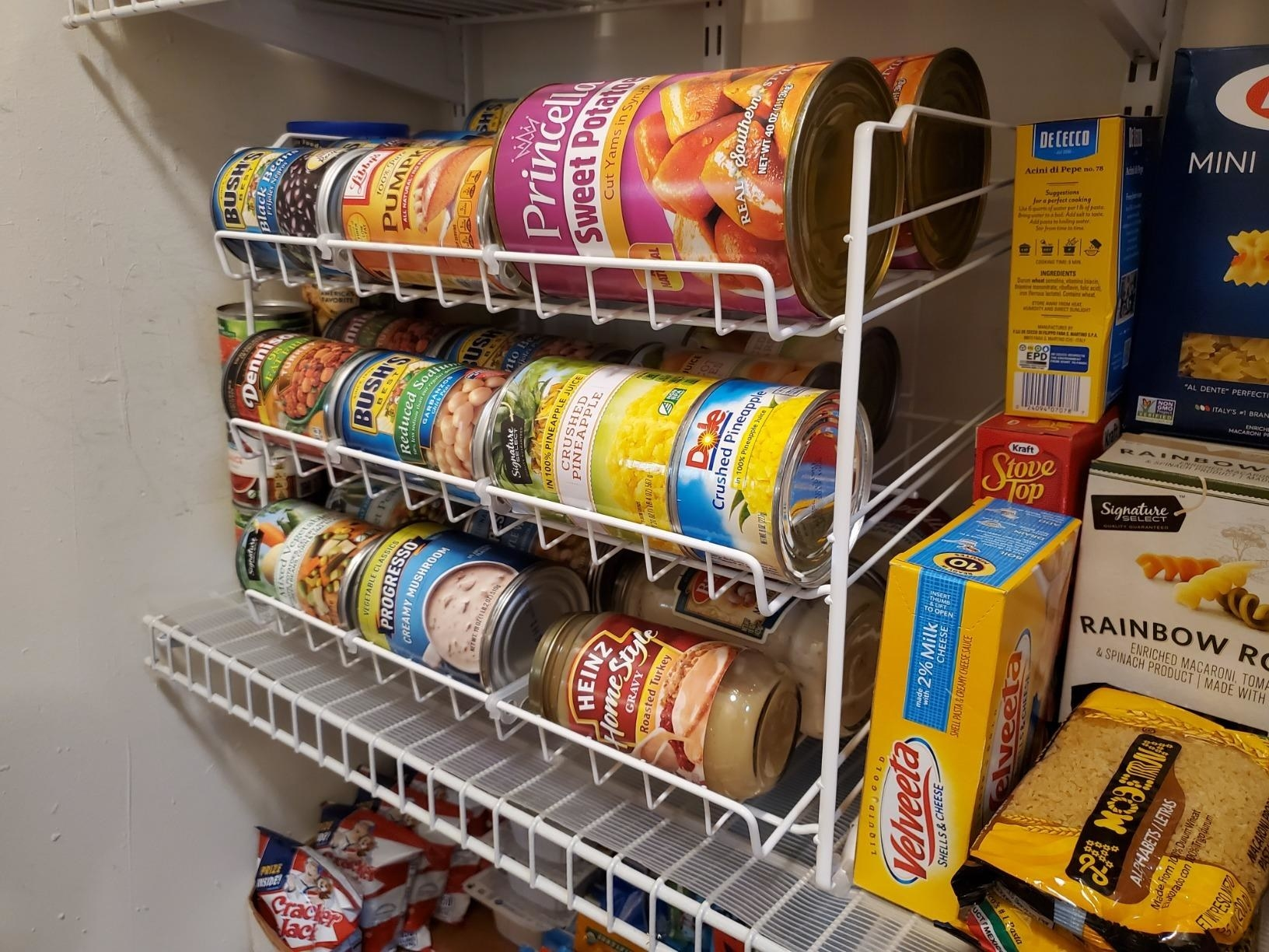 reviewer image of the white simplehouseware stackable can rack in a pantry