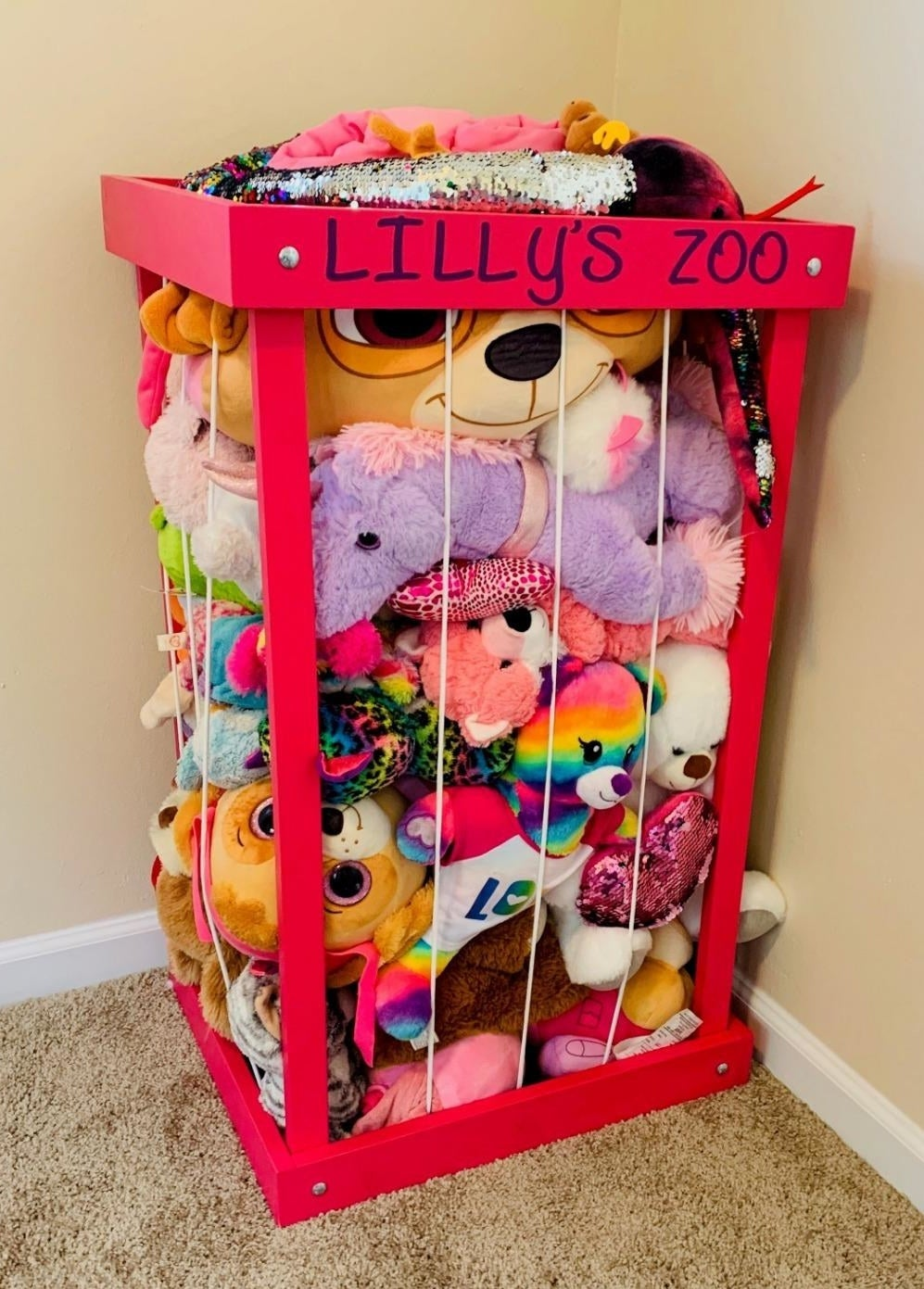 "A pink stuffed animal zoo customized with ""Lilly's zoo"""