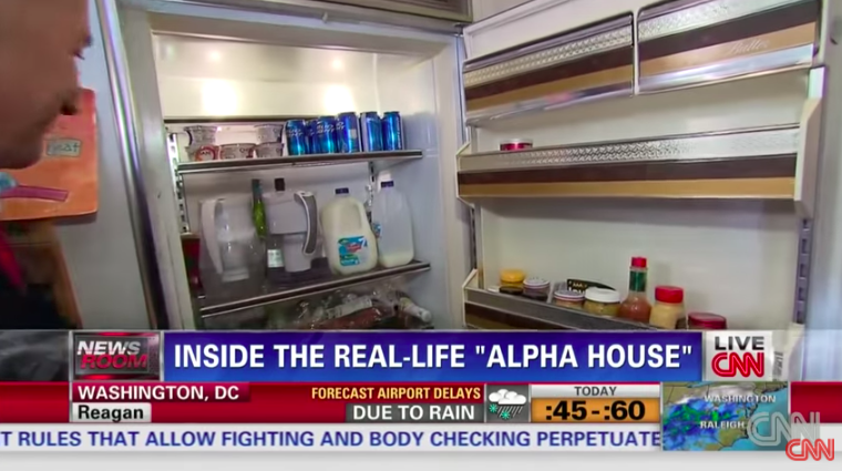 The fridge is filled with beer, milk, two partially-filled water filters, and condiments such as hot sauce and mustard
