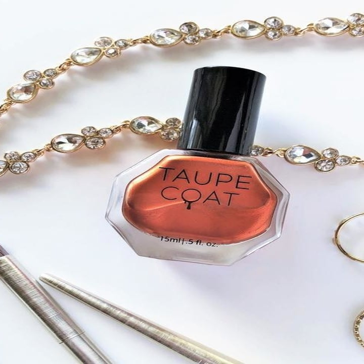 Nail polish on table with jewelry