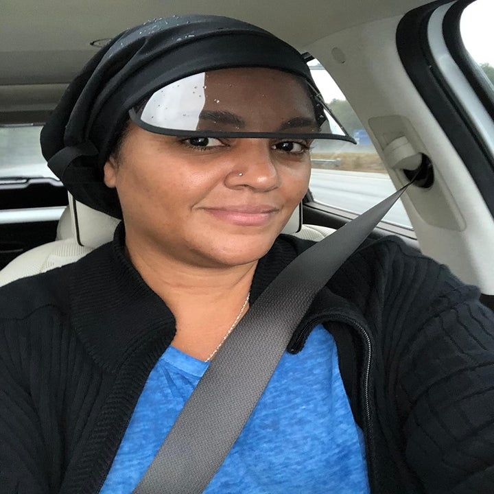 Reviewer wearing the satin cap with clear visor
