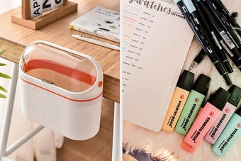 A white and pink wastebasket and a pile of pastel highlighters