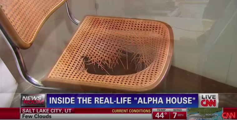 A wicker chair with a huge hole in the seat