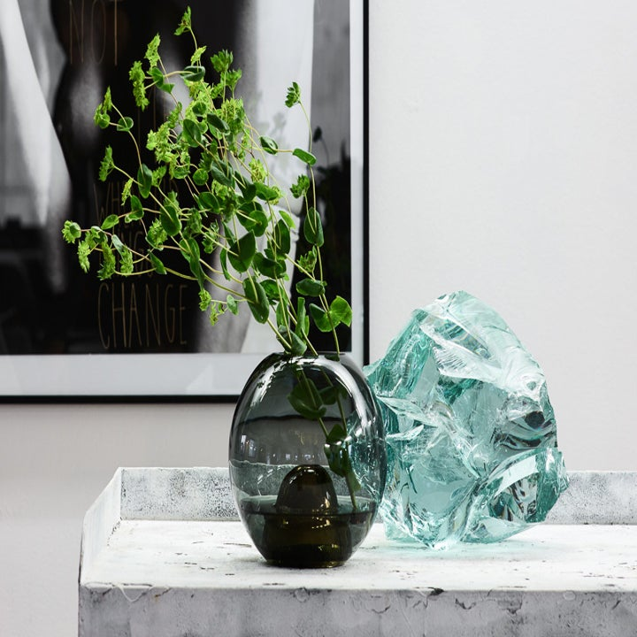 Circular vase with branches inside