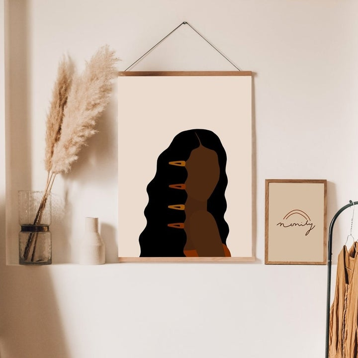 Minimalist print of Black person with long hair and clips all down the front of their hair