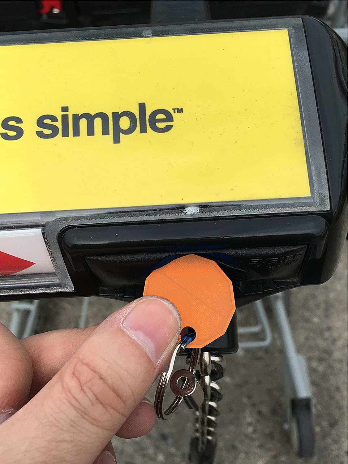 person using the coin to release a shopping cart