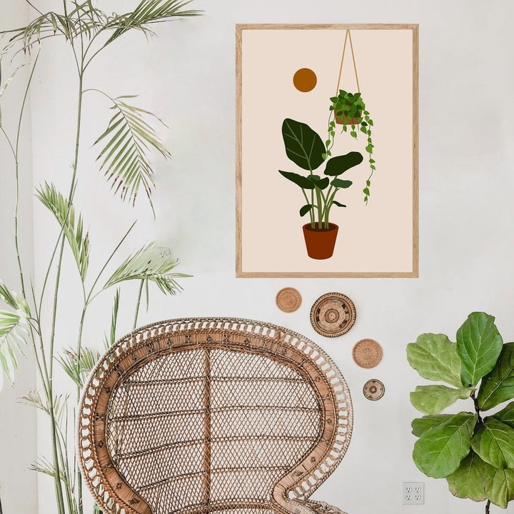 Similarly stylized print of a potted plant, hanging plant, and sun