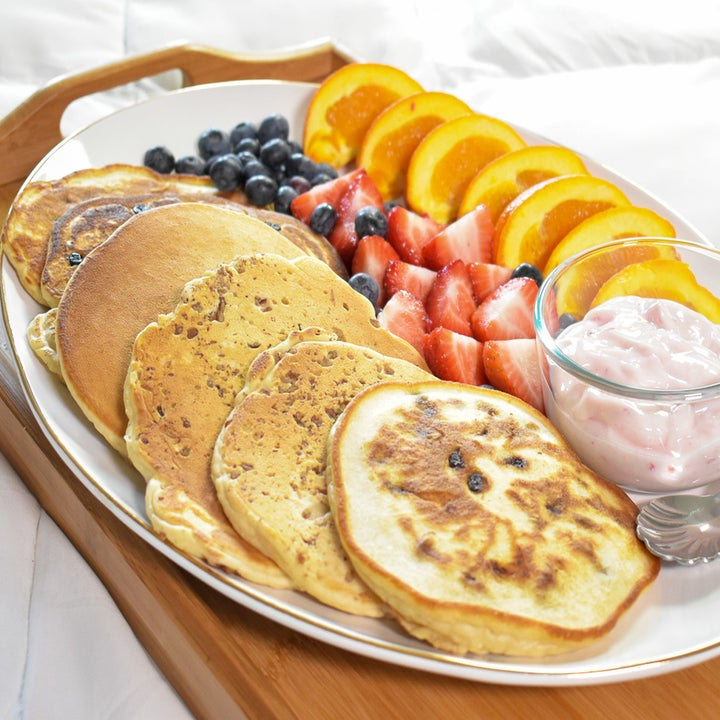 A platter of pancakes and fruit