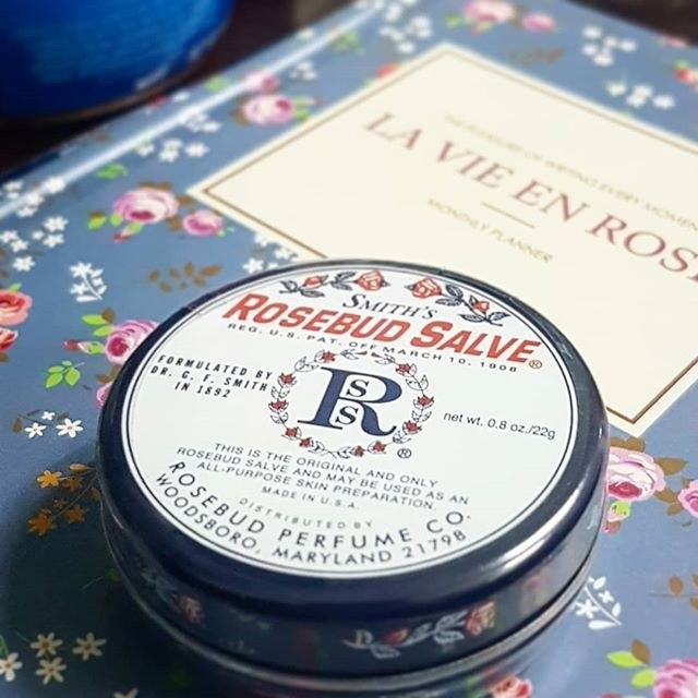 A small tin of salve on a book