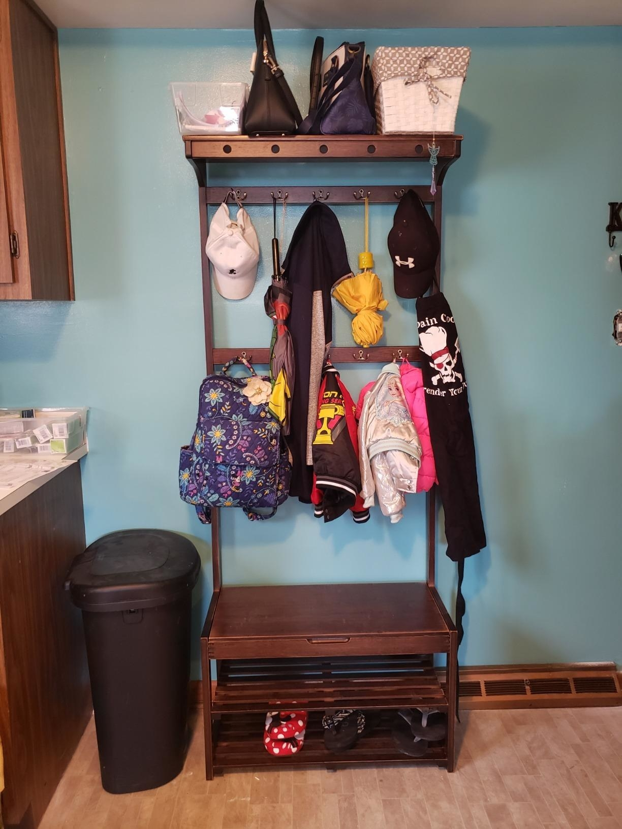 reviewer image of kids shoes, coats, and backpacks hanging from the SEIRIONE Bamboo Coat rack