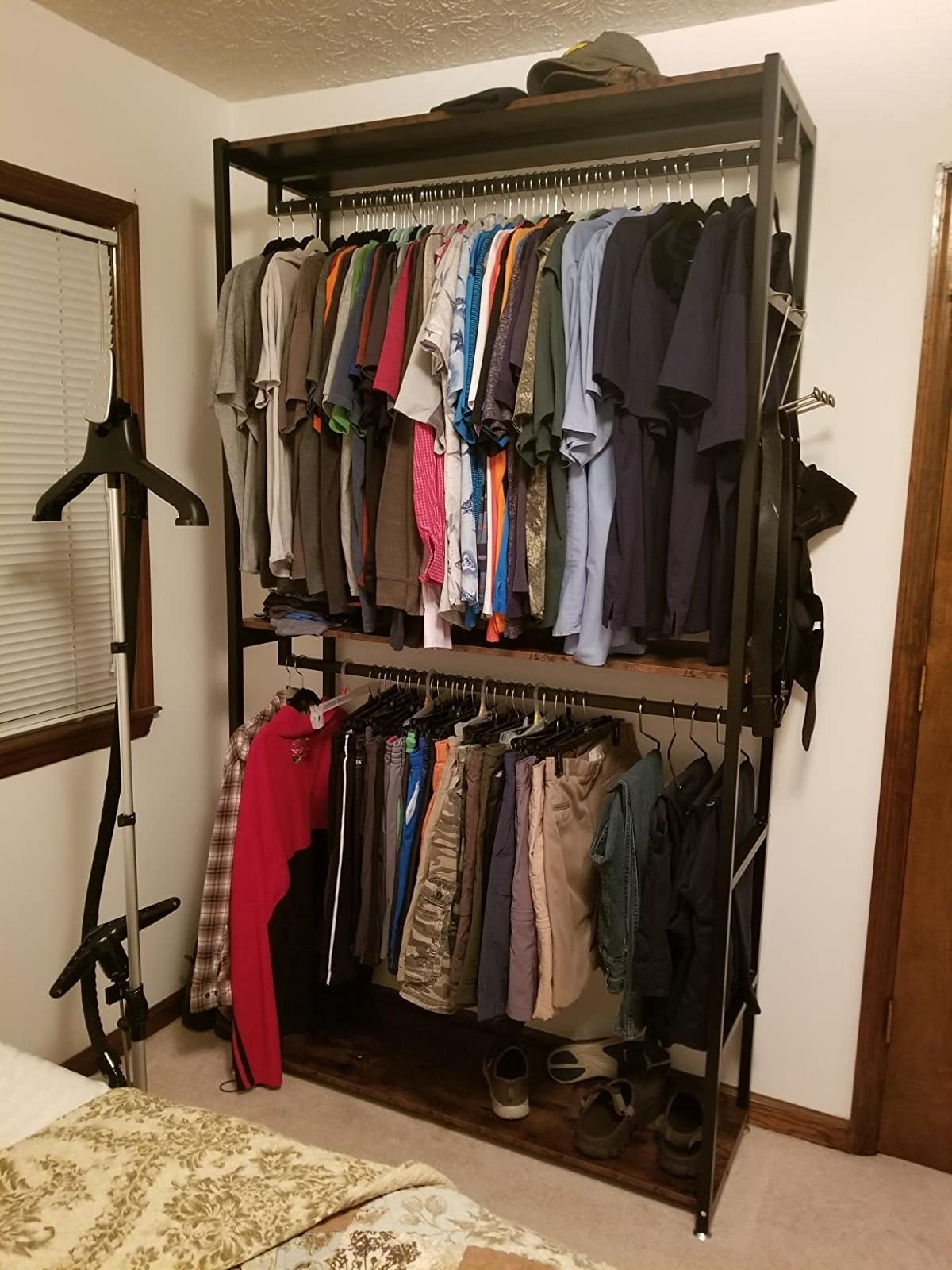 reviewer image of clothes hanging from a tribesigns double rod closet organizer