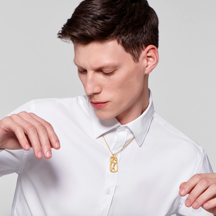 Model wearing gold necklace