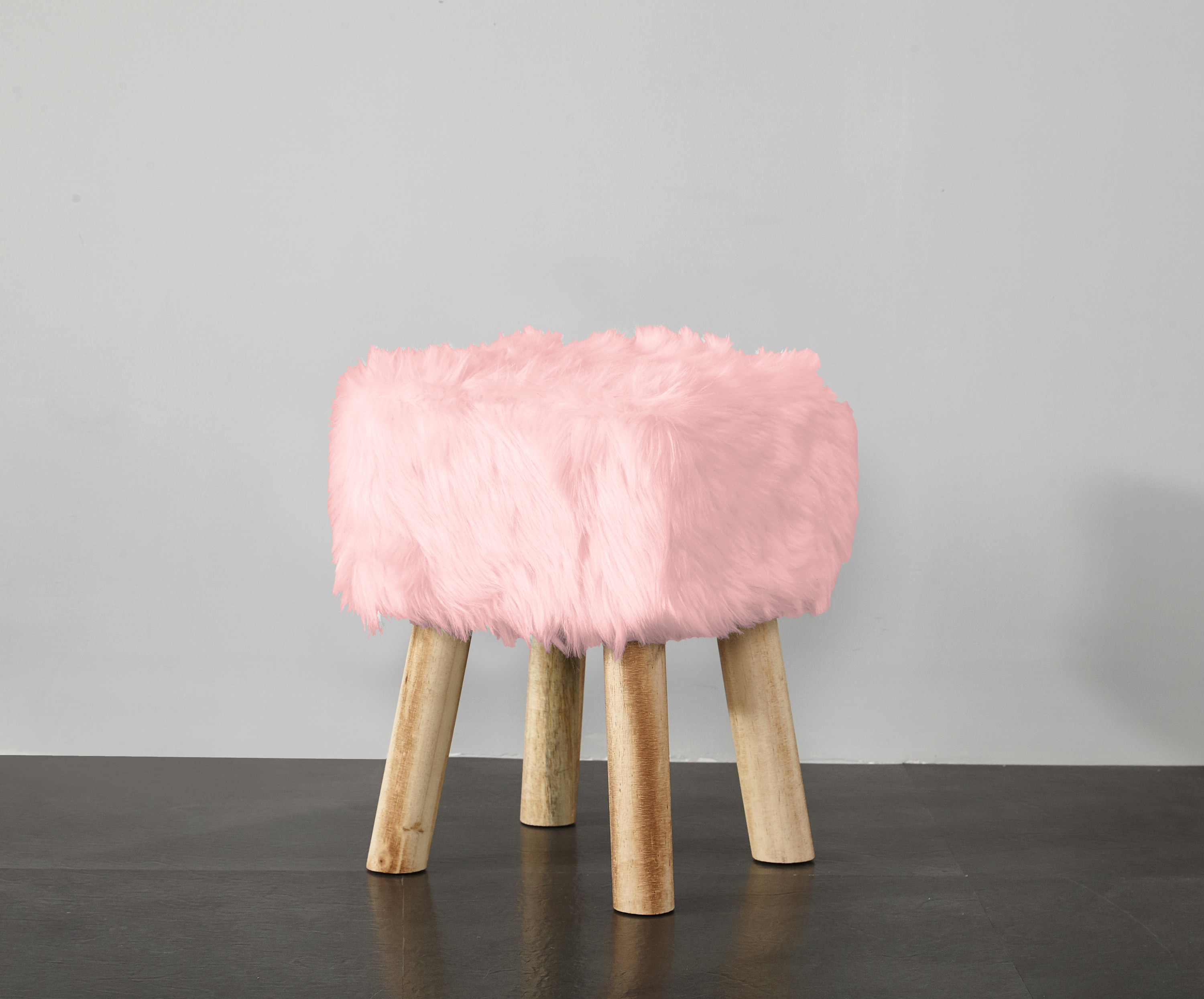 The pink faux fur stool