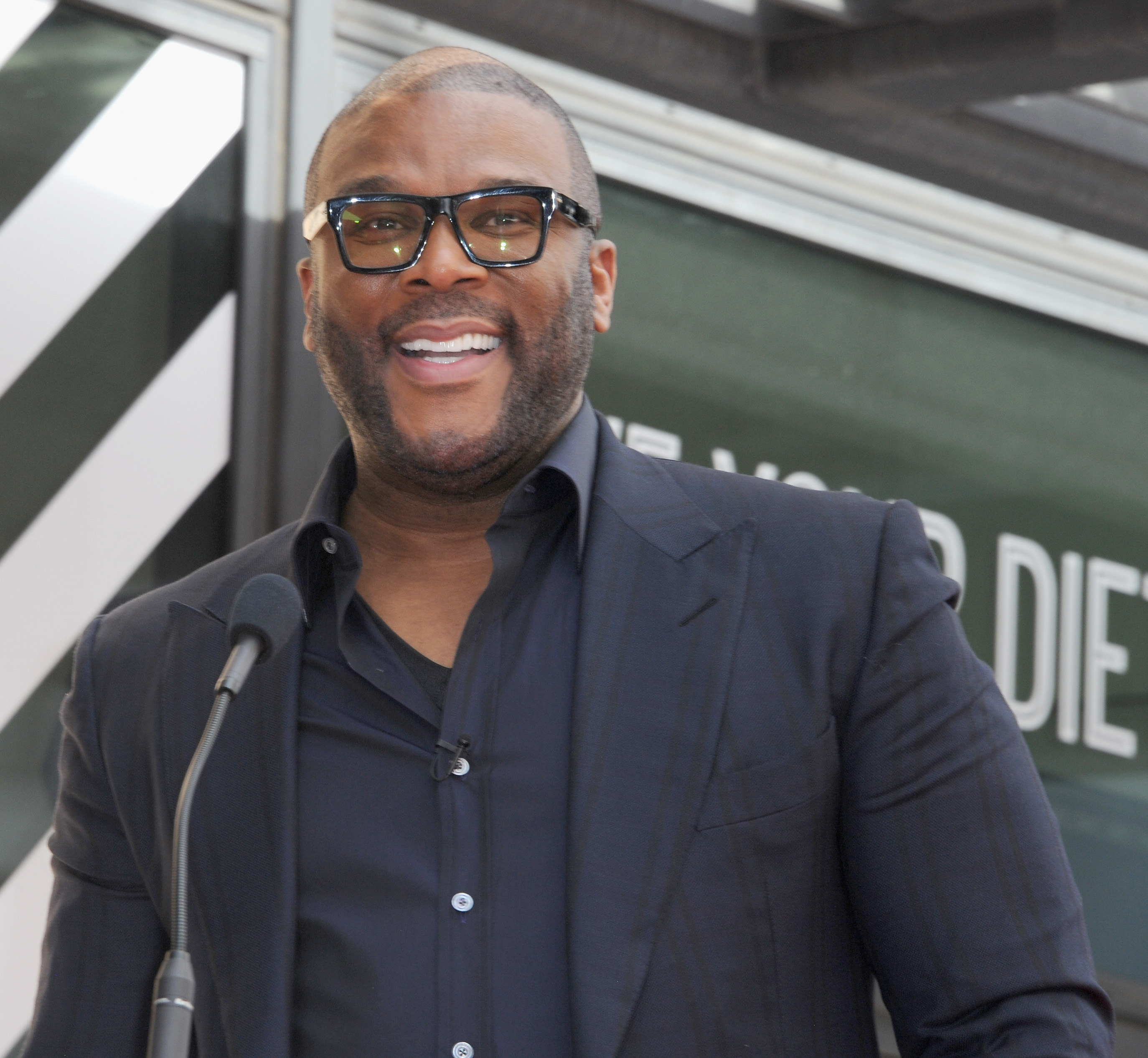 Tyler Perry smiling as he speaks at the Dr. Phil McGraw Star Ceremony On The Hollywood Walk Of Fame