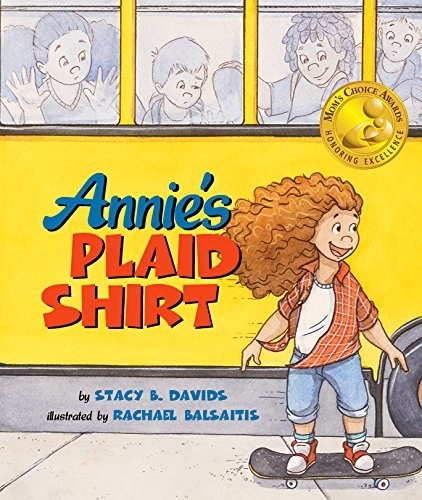 Annie skateboarding past a school bus full of kids