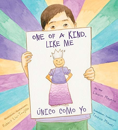 Danny holding up a drawings of himself in a dress and crown