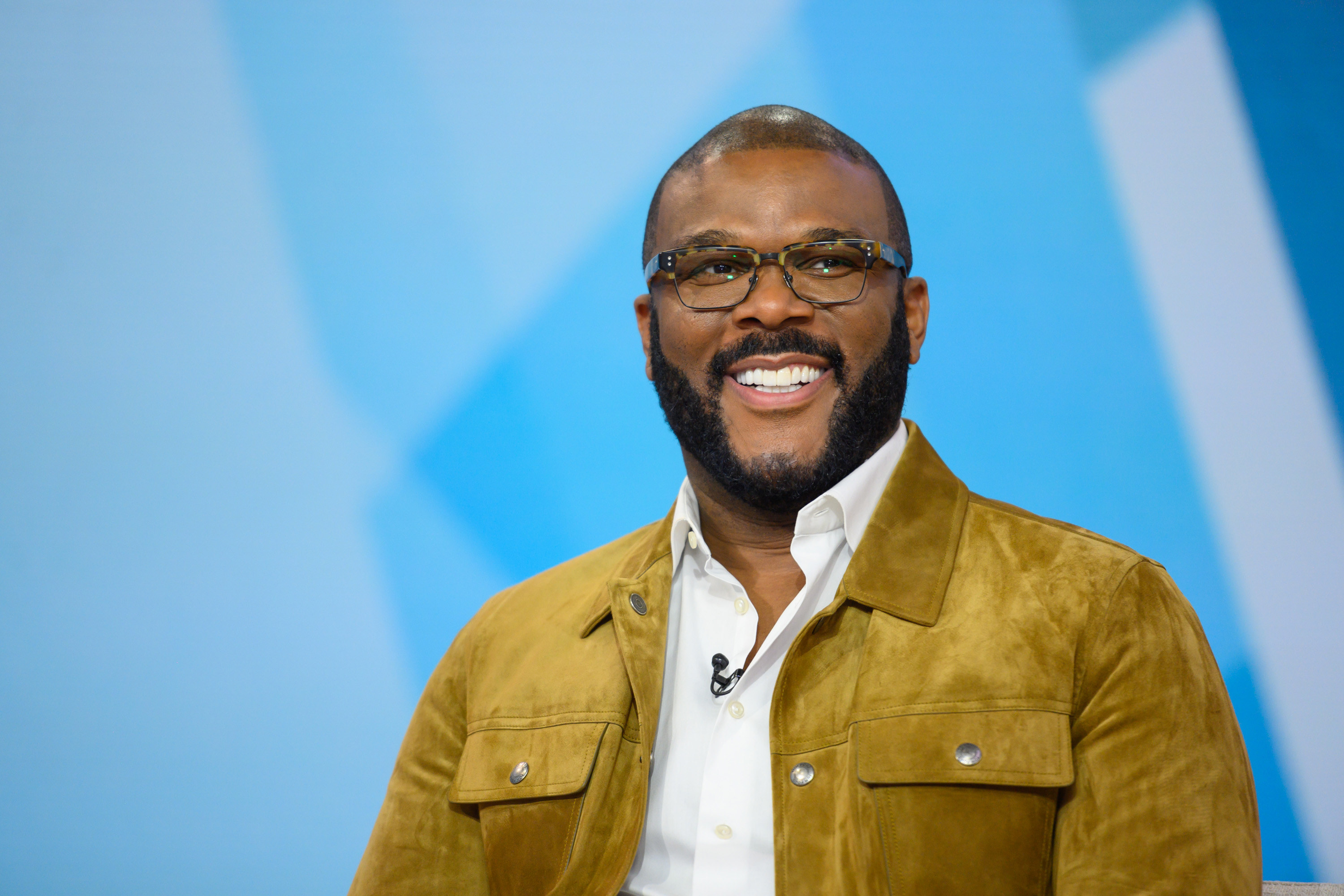 Tyler Perry, wearing a jacket and dress shirt, during his appearance on the TODAY show