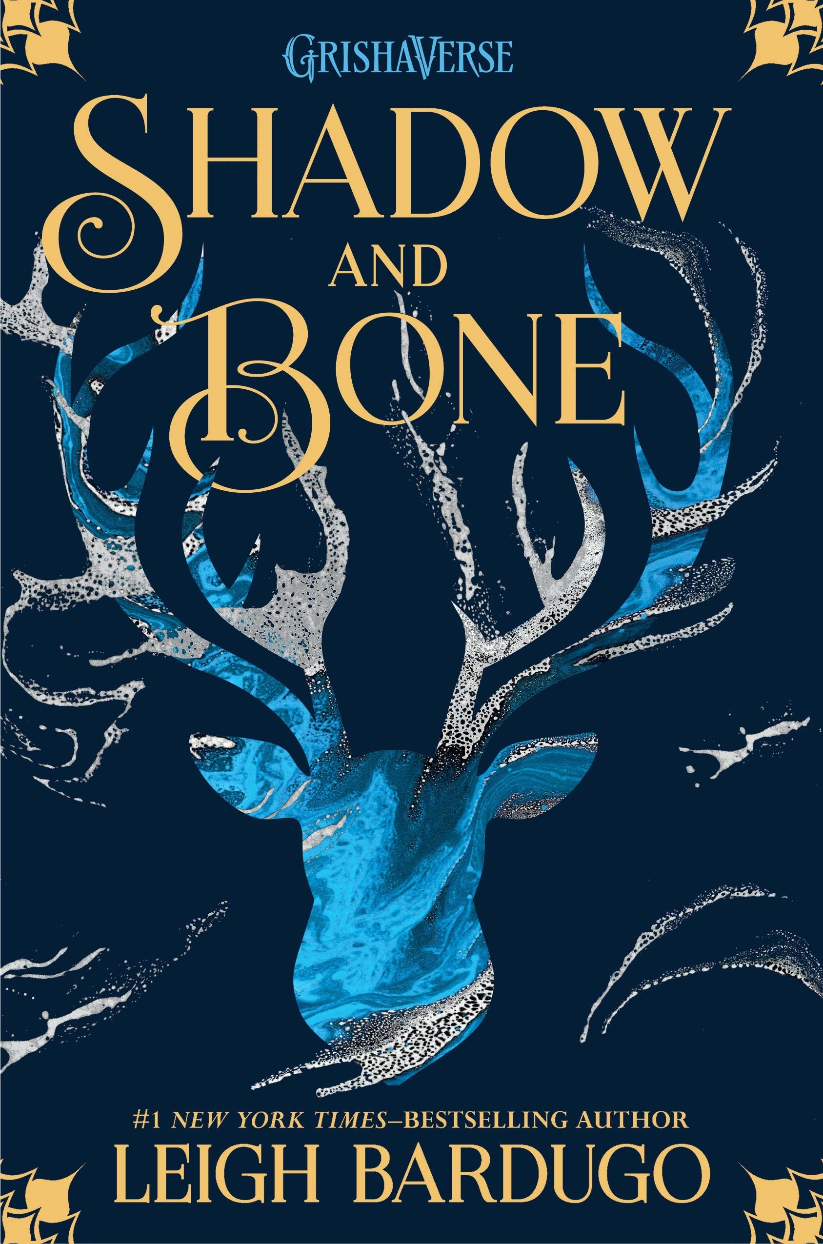 "The ""Shadow and Bone"" book cover which features a light blue and white-swirled deer"