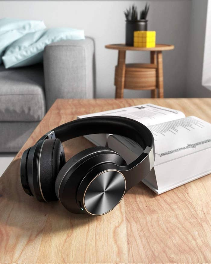 pair of headphones laid on a book