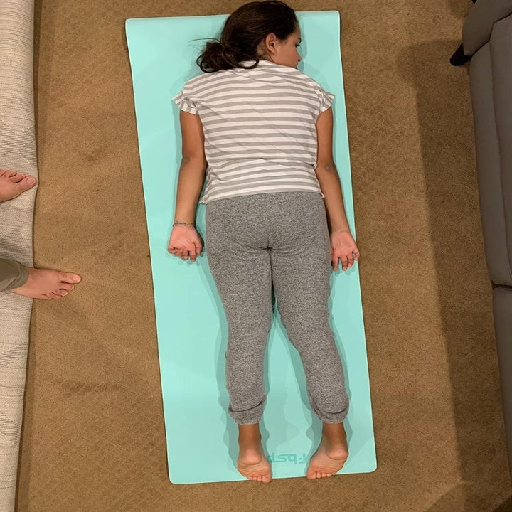 Reviewer laying on yoga mat