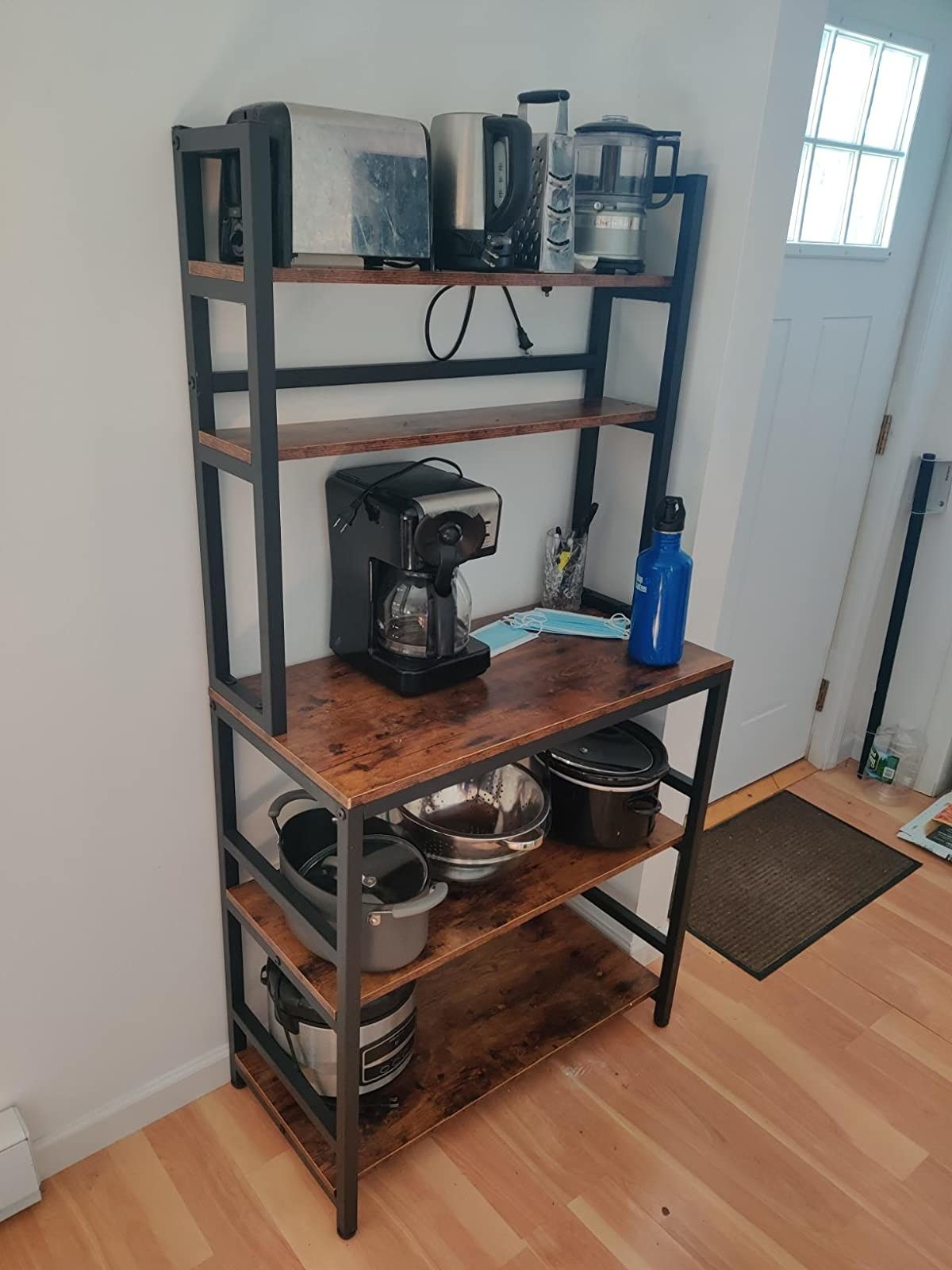 reviewer image of kitchen utensils stored on a rustic brown Tribesigns 5-Tier Kitchen Bakers Rack