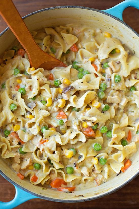 A pot of chicken pot pie noodles with veggies in cream sauce.