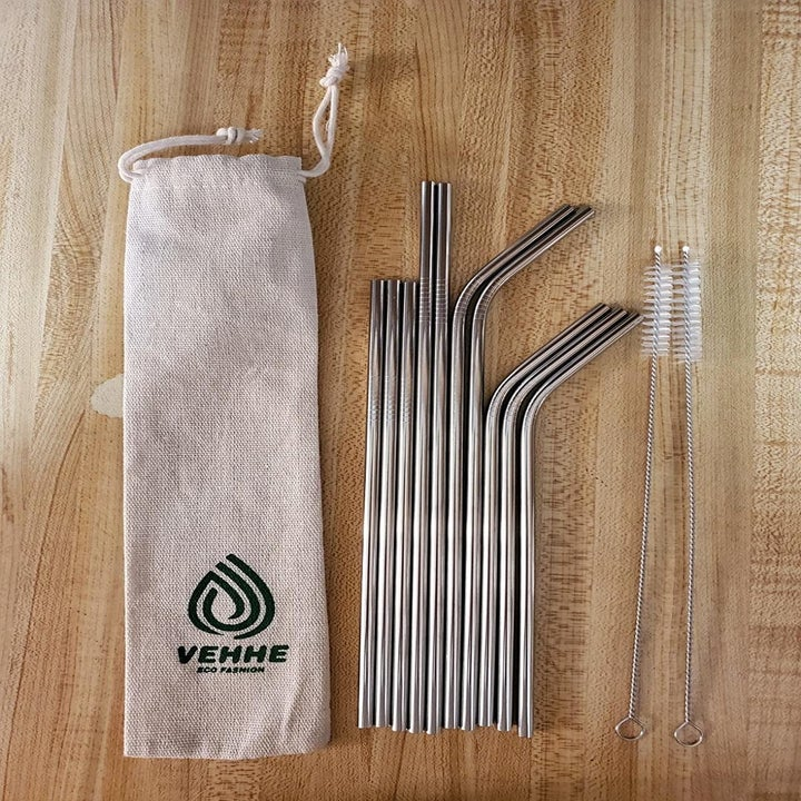 Reviewer opened bag of reusable straws on table