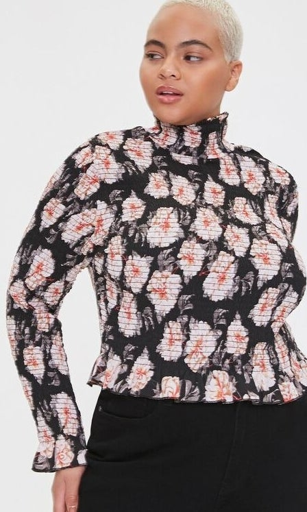 Model wearing a floral top