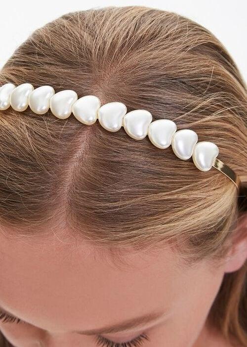 Model wearing a pearl heart headband