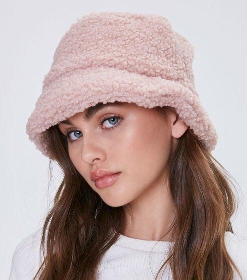 Model wearing pink bucket hat