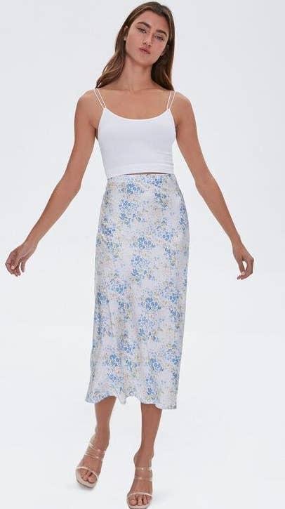 Model wearing floral print midi skirt