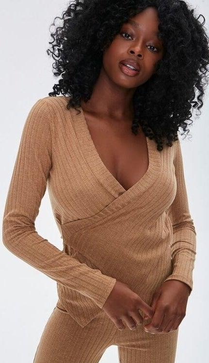 Model wearing tan ribbed top