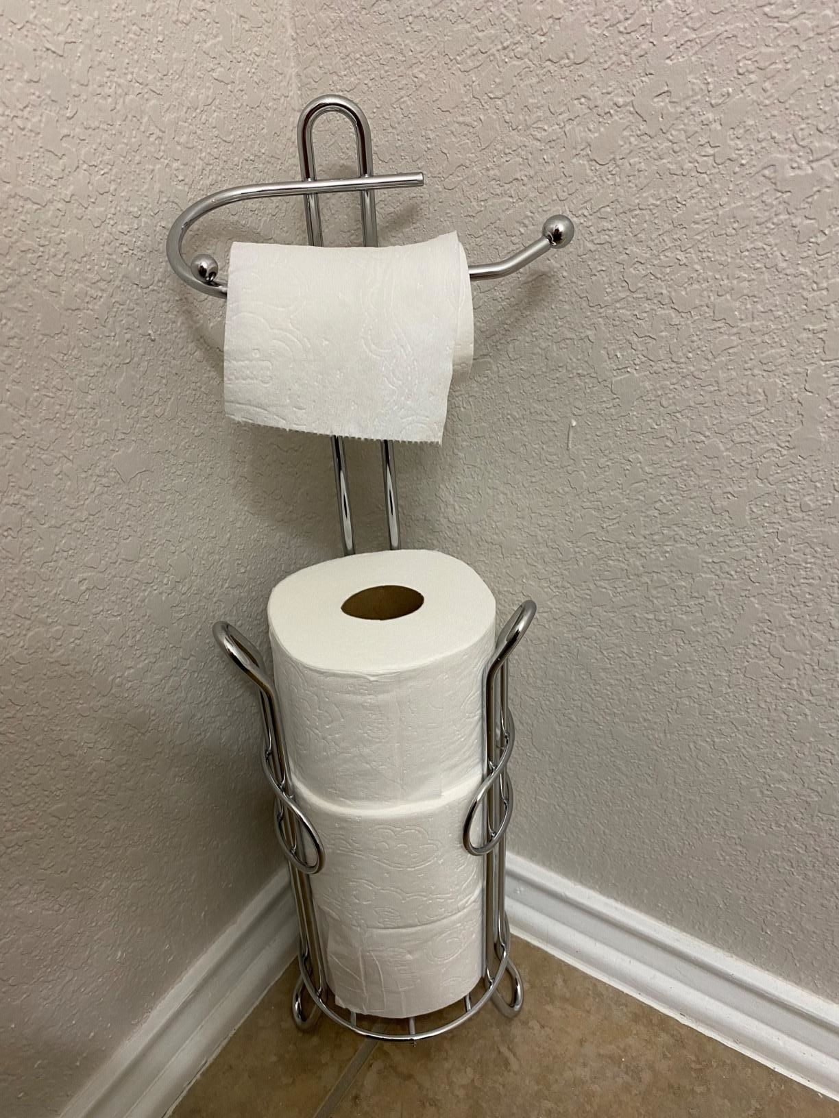reviewer image of toilet paper stacked in the chrome SunnyPoint Bathroom Toilet paper holder