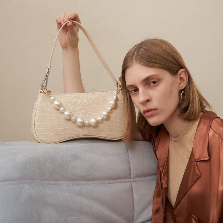 model with eva baguette bag