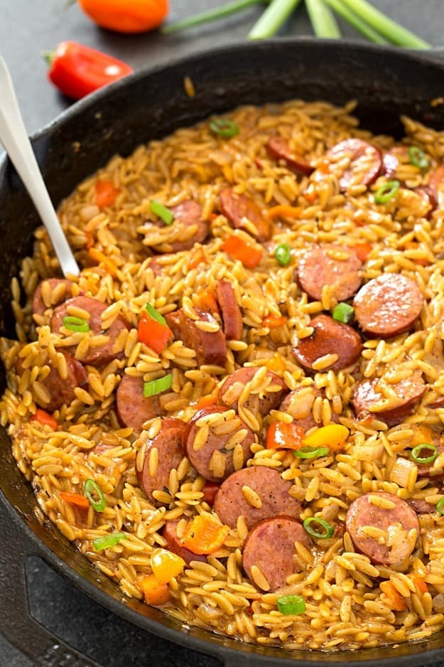 A creamy orzo skillet with sausage.