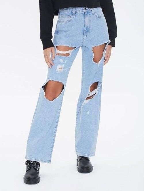 Model wearing ripped boyfriend jeans
