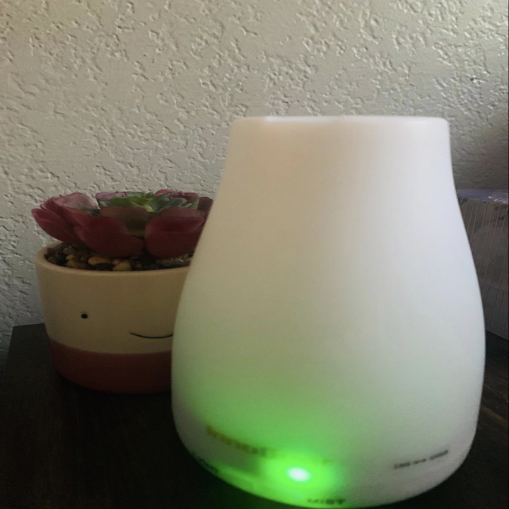Reviewer image of small white diffuser on desk