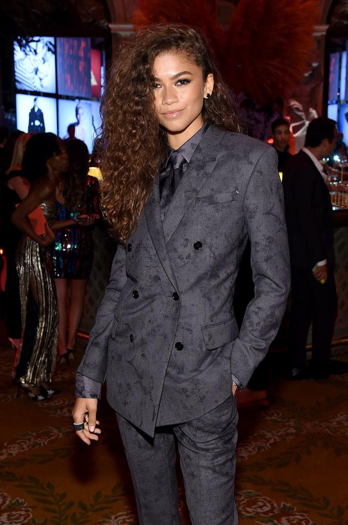 Zendaya posing in a traditionally male suit.
